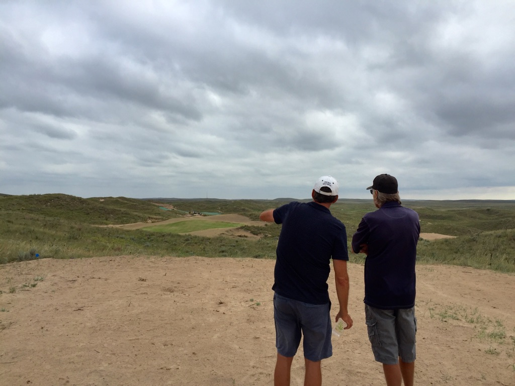 Eric Iverson and John Curlander overlook the early growth on The Mulligan Course.